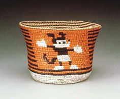 ED ROSSBACH Mickey Mouse Coil Basket, 1975; synthetic raffia, sea grass; coiled with imbrication; 6 by 9 by 9 inches.
