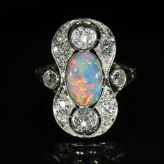 Stunning Edwardian Black Opal and Diamond Ring Mounted In Platinum   c.1905