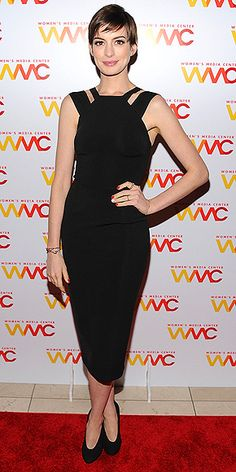 ANNE HATHAWAY  Now that we know that the pixie cut is here to stay, we can really get behind it. At the Women's Media Awards in N.Y.C., the star sweeps it to the side to accent her cutout black sheath and simple heels.