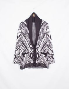 Bold printed grandpa cardigan with faux leather elbow patches from Cynthia Vincent.