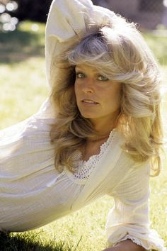 Remembering Farrah Fawcett | The Zoe Report - Posing for a photo on the set of Double Jeopardy, 1975.