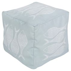 Showcasing a fish motif in sky blue and ash gray, this eye-catching pouf lends nautical appeal to your living room or den.  Product:...