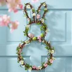 Bunny Wreath - Complete with big bunny ears, grasses, eggs and blossoms. #easter #easterdecor #decor #homedecor