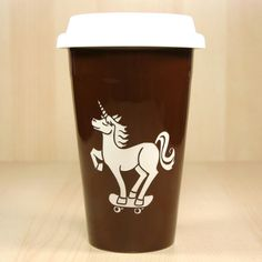 This reusable unicorn skateboarding travel coffee cup comes in black or java brown. The double-walled ceramic keeps your coffee hot, and your hands cool. Ceramic travel coffee mugs - - dishwasher-safe