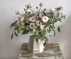 Country bouquet of honeysuckle & ranunculus by Ariel Dearie