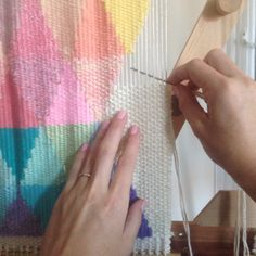 Weaving a wall hanging tapestry on the loom by Maryanne Moodie.