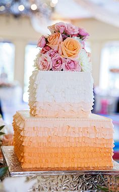 This Disney's Fairy Tale Wedding ombre ruffle frills cake is layer upon layer of deliciousness