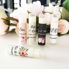 """Personalized Floral Garden Lip Balm Tubes ( Min 16 Units) Personalized Floral Garden Lip Balm Tubes make practical favors for any garden themed event! Lip balm labels can be personalized with your color, style, text. Due to the personalization for this product, the minimum order is 16. Lip balm tubes arrive separate from the labels. Some assembly required (attaching the self-stick labels to the tubes). Size: 2 5/6"""" x 1/2"""" Max Characters per line (including spaces):Script Text: 20 CharactersBold Coffee Wedding Favors, Honey Wedding Favors, Succulent Wedding Favors, Creative Wedding Favors, Inexpensive Wedding Favors, Elegant Wedding Favors, Edible Wedding Favors, Wedding Shower Favors, Personalized Wedding Favors"""