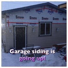 Garage siding is going up!