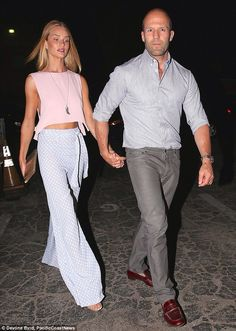 naimabarcelona:  July 28-2014 | Rosie Huntington-Whiteley looks pretty as a petal in blush pink crop top on romantic dinner date with Jason Statham