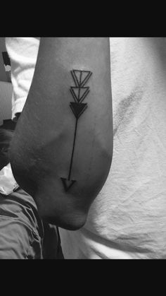 First tattoo of an Arrow I designed. Roman Numeral V represents the five members of my family and the three triangles for me and my siblings.