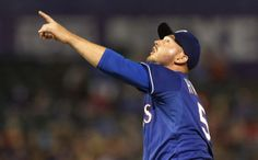 Texas starting pitcher Matt Harrison points to a pop fly that was caught for the final out in the fifth inning during the Colorado Rockies vs. the Texas Rangers major league baseball game at Globe Life Park in Arlington, Texas on Thursday, May 8, 2014. (Louis DeLuca/Dallas Morning News)
