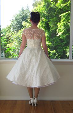 1950's Style Ivory Wedding Dress with Polka Dot Overlay, Sweetheart Neckline and Tea Length Skirt and Petticoat - Custom made to fit. $310.00, via Etsy.