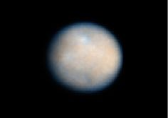 NASA's Dawn spacecraft is set to begin orbiting the dwarf planet Ceres next month, and a new series of simulations indicate that it may find a strange world of ice volcanoes and a thin frozen shell covering a mud ocean that might harbor life.