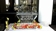 Ice sculpture for a college graduation celebration as a centerpiece to a food display.