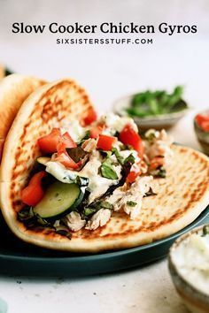 This Slow Cooker Chicken Gyros Recipe is tangy, delicious chicken topped with fresh vegetables and creamy Tzatziki sauce. This recipe is so simple and makes a fresh, light dinner everyone will love! Recipe Using Chicken Breasts, Chicken Gyro Recipe, Chicken Gyros, Easy Chicken Recipes, La Chicken, Crock Pot Slow Cooker, Slow Cooker Chicken, Slow Cooker Recipes, Crockpot Recipes