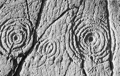 Stone carvings of labyrinth figures from Argyll, Scotland, dating from the Neolithic or Early Bronze Age.