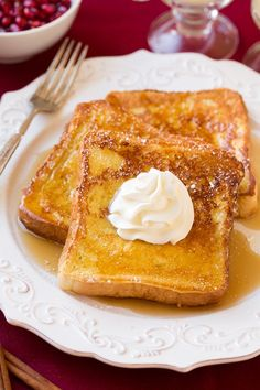 Eggnog French Toast - I'm sure I will be turning to this french toast recipe many times this season. It tastes just like eggnog but in perfectly golden and buttery french toast form. Serve this up with sweetened whipped cream (a holiday must right?) and those irresistible slices of salty, crisp bacon we all crave, and you've got a holiday meal worth remembering.