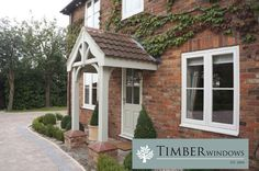 Case study from Timber Windows of Harewood which includes a Front Door, Flush Casement Windows and French Doors.