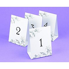 @Overstock - These white table tent cards feature black numbers and a decorative grey flourish design. The tent-style cards are freestanding, and ideal for assigning seating to wedding guests. http://www.overstock.com/Gifts-Flowers/Wedding-Table-Number-Tents/6790028/product.html?CID=214117 $16.99