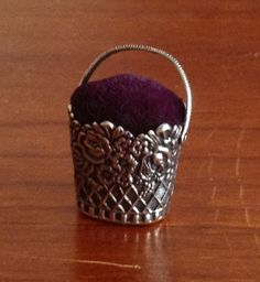 silver basket pincushion