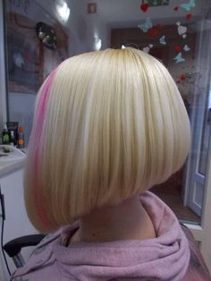 Such a perfect bob! And the pink streak just sets it off. He would have to sit for hours to get his hair that blonde. To add that pretty pink streak on top of it. Adorable!