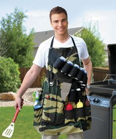 """Grill Sergeant BBQ Apron $13.95 Lakeside Collections. Camouflage apron has pockets for grill tools, sauces and spices. It also comes with an artillery belt that holds 6 beverage cans or bottles and has a built-in bottle opener. Adjustable; one size fits all. 32"""" x 32"""". Cotton."""