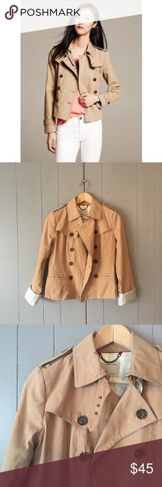 "Banana Republic Cropped Trench in Baked Sand Super cute Trench in excellent condition! From their limited Heritage Collection line. This would be an ideal rain coat for all seasons as well. Very mild stain on back lower part (see last pic). Armpit to armpit is 17"". Length is 21"". Offers are always welcome. Banana Republic Jackets & Coats Trench Coats"