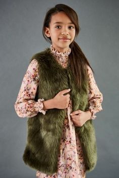 Green and Christmas go hand in hand, so why not pair your beautiful dress with this khaki faux fur gilet!