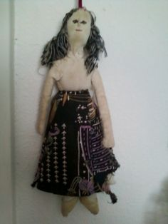 Abuelita's doll. Hand stitched in 1915.