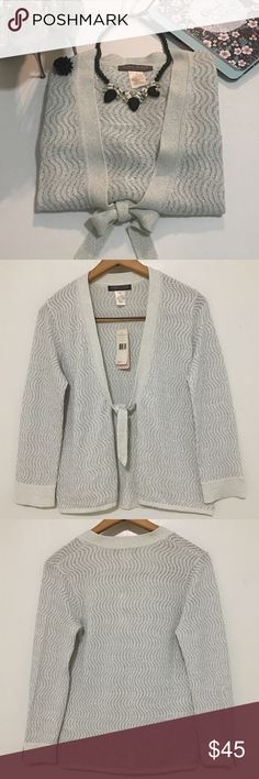 """Sigrid Olsen Sparkle Open Tie Front Cardigan NWT! Sigrid Olsen Collection—Orchid Moon Cardigan: Small. Silver Sparkle. Open-Tie Front. 3/4, Split Sleeves. Textured. Career. Made of: 67% Viscose. 17% Nylon. 11% Polyester. 5% Metallic Fibers. Pit To Pit: 18.5"""" (37"""" All Around). Length: 22"""" *Measurements are approximate* *Garment shows several snags* Sigrid Olsen Sweaters Cardigans"""