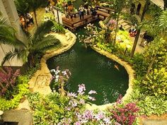 You know sometimes when you have days when you just dont feel like doing anything? Well I would love to spend one of those days just sitting amongst those flowers, watching the fishes in the pond go by #Bali www.asiahomegarden.com