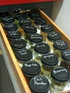 Spice drawer organization using baby food jars with chalkboard paint lids. Too bad Baby food jars are starting to come in plastic containers.