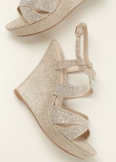 A little extra sparkle goes a long way with these crystal embellished high heel wedge sandals!  Wedge sandals are decorated with crystals along the straps.  Heel Height:4 inches.  Available in Nude Metallic and Silver Metallic.  Available in sizes 5.5-9, 10.  Imported.
