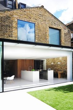 The latest projects and news from architecture studio Bureau de Change, including a London house extension with a dark blue kitchen. Orangerie Extension, Architecture Design, Architecture Origami, Contemporary Architecture, Glass Extension, Extension Ideas, Extension Google, Rear Extension, Design Exterior
