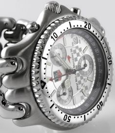 TAG Heuer - SEL Chrono 'West McLaren Mercedes 98' : CG1117 : Stainless Steel head and bracelet with flip-lock, unidirectional rotating diver bezel, silver dial, quartz, 12-hour chronograph with 1/10 seconds, date, screw-down crown, Limited Edition of 3999, Ref. CG1117, ca. 1999, 36mm, Like New