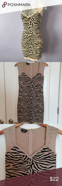 Bebe Tiger Print Bodycon Dress Tan and black bodycon with zipper in the back Pre-owned but gently used. No snags or piling  Length 34 inches Dress is not yellow, it is tan (see pictures) bebe Dresses Mini