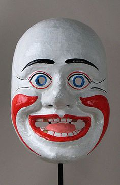 Clown mask  Latacunga, Ecuador  11 inches, papier mache  The clown is an important character in La Fiesta de la Mama Negro, a popular annual celebration in the Quechua-speaking town close to Mt. Cotopaxi south of Quito in the center of Ecuador. The customs and characters of this event are quite unique, and it attracts tourist every year.