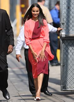 Bright and cheery! Zoe Saldana wore a vibrant and summery coral pink dress when she arrive...
