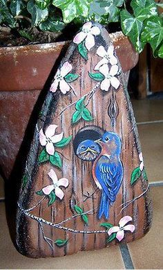 Bluebird Birdhouse - gorgeous...I even have a stone this shape...something for my garden in the spring