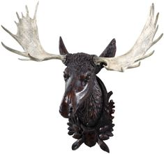 Cool Moose Head.  A resin replica of original black forest carving.