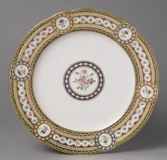 Plate from a Dinner Service of Queen Marie-Antoinette of France 1784 Sèvres Porcelain Factory, Sèvres, France In January of 1784, Marie-Antoinette, queen of France, ordered a dinner service for use in her newly redecorated apartments at the Tuileries palace in Paris. The service, numbering two hundred and fifteen pieces, was completed in May 1784. .