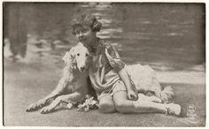 Old photo with girl and borzoi at the beach