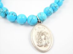 Handmade Saint Rita Catholic Medal Faux Blue Turquoise Stretch Bracelet - Patron Saint Jewelry -Dyed Howlite Bracelet - Saint of Mothers by LuxMeaChristus on Etsy