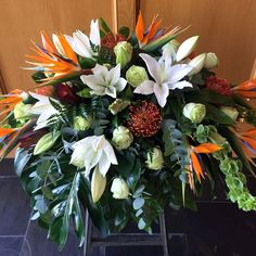 sympathy flowers by brookside blooms, an exceptional Tulsa florist delivering unique fresh flowers for all occasions and events Funeral Floral Arrangements, Tropical Flower Arrangements, Tropical Flowers, Fresh Flowers, Casket Flowers, Funeral Flowers, Funeral Sprays, Casket Sprays, Cemetery Flowers