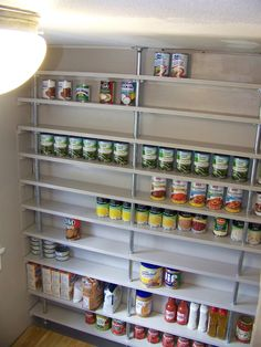 DIY pipe pantry shelves-- for the little nook in the garage? I showed this to my hubby & am hoping that he will either use this idea or one of his own.