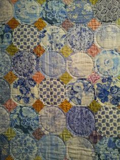 Kaffe Fassett quilt. snowball block quilt with circle quilting to give the block a different look