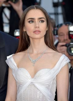 "Lily Collins Photos Photos - Actress Lily Collins attends the ""Okja"" screening during the 70th annual Cannes Film Festival at Palais des Festivals on May 19, 2017 in Cannes, France. - 'Okja' Red Carpet Arrivals - The 70th Annual Cannes Film Festival"