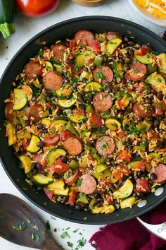 One Pan Sausage Zucchini and Brown Rice Skillet, umm yes please! Easy healthy weeknight dinners are totally my thing, because that means there's room left