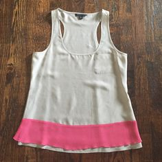 Banana Republic Light Grey Silk Tank Light weight 100% silk tank in light grey with pink trim at the bottom. Worn only once. Can be paired with a blazer and skinny jeans. Perfect for spring/summer. ***No Trades*** Banana Republic Tops Tank Tops